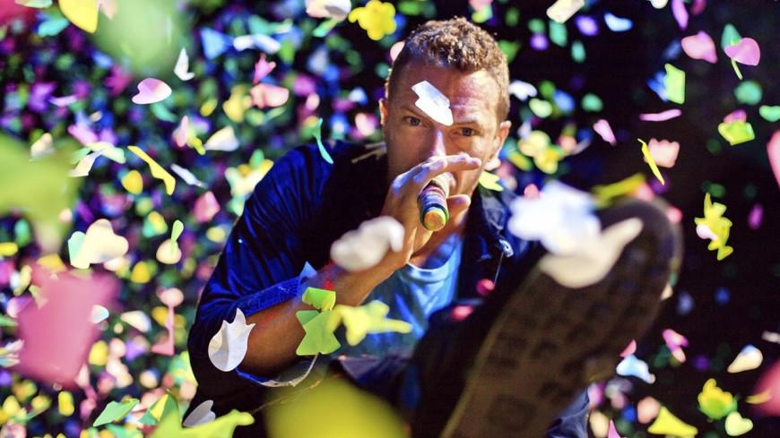 Un fan accompagne Coldplay à l'harmonica